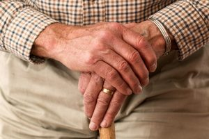 Elderly help at home with a cane